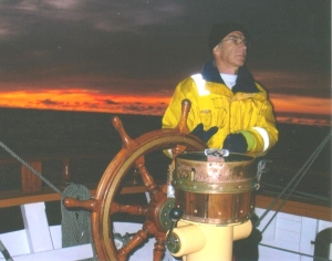 Brian Hodgson at the helm of Lady Nelson