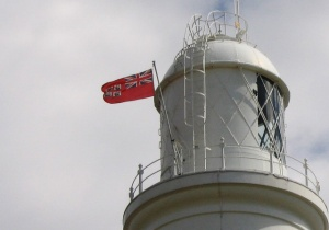 Trinity House flag flying on Portland Bill lighthouse