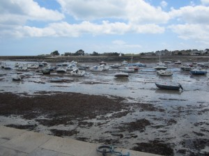Barfleur has a huge tide range; the harbour at low water