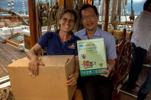 Meggi with Robert Nyo, one of the donors of supplies that will be delivered to remote schools