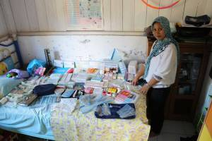 Medang Island midwife Mitha recieves her yearly resupply of medi